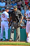 10 June 2012: Home plate umpire Alan Porter walks away from Boston Red Sox Manager Bobby Valentine after ejecting Valentine in the 9th inning of play against the Washington Nationals at Fenway Park in Boston, MA. The Nationals defeated the Red Sox 4-3 to sweep their 3-game interleague series. Mandatory Credit: Ed Wolfstein Photo