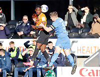 Simeon Akinola (L) of Barnet wins a header from Josh Granite during Barnet vs Barrow, Buildbase FA Trophy Football at the Hive Stadium on 8th February 2020