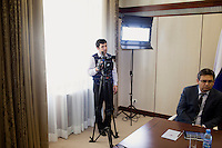 A television camera man records an interview with the president of Bashkortostan in Ufa, Russia.