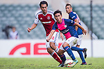 Kyungjin Jang of Kitchee (R) being followed by Sean Ka Keung Tse of SCAA (L) during the HKFA Premier League between South China Athletic Association vs Kitchee at the Hong Kong Stadium on 23 November 2014 in Hong Kong, China. Photo by Aitor Alcalde / Power Sport Images