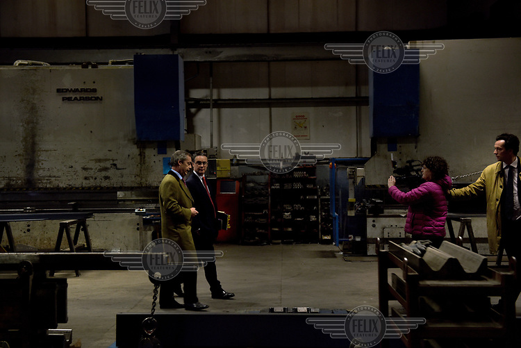 UKIP leader Nigel Farage gives a 'walk and talk' interview to Channel 4 news at the Concept Metals factory where he introudced his party's economics policy during campaigning for the 7 May 2015 general election.