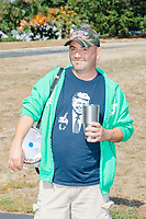 A man wears a shirt depicting President Donald J. Trump extending his middle finger as alt-right organization Super Happy Fun America demonstrates against facemasks, vaccines, and pandemic closures, and in support of the reelection of President Donald J. Trump near the residence of Massachusetts governor Charlie Baker in Swampscott, Massachusetts, on Sat., Sept. 26, 2020. Super Happy Fun America is most well known for organizing the Straight Pride Parade in Boston on August 31, 2019.