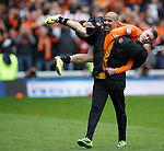 Farid El Alagui carries Ryan Gauld off the park to celebrate at the end