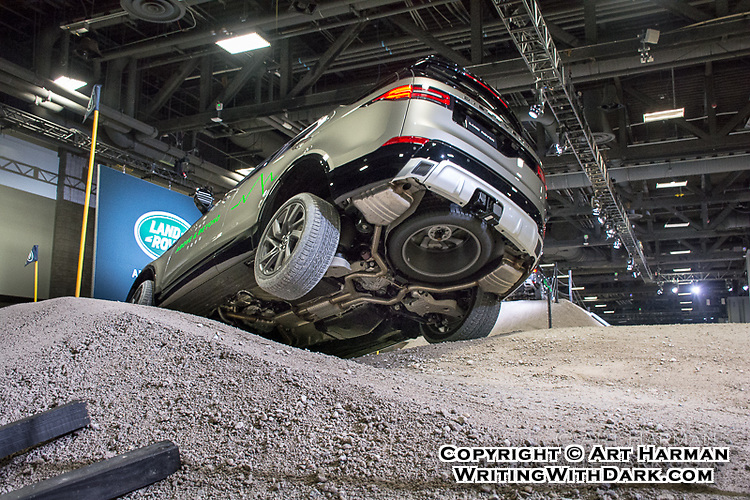 Capturing the moment that communicates. Whatever your product, there's some way to highlight what your customers most want. Car demo shot by Art Harman at Land Rover exhibit. Challenge: Show the rugged off-road capabilities of the vehicle.