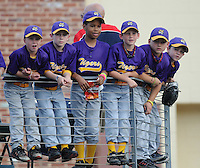 Several young ballplayers hang onto a railing, watching Greenville Drive players warming up prior to a game on May 20, 2010, at Fluor Field at the West End in Greenville, S.C. Photo by: Tom Priddy/Four Seam Images