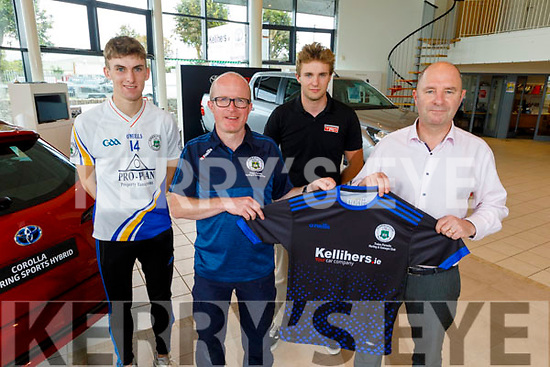 Brian Shanahan of Tralee Parnells receives new training tops from Tim Kelliher of Kellihers Garage on Tuesday. Front: Brian Shanahan and Tim Kelliher. Back: Darragh Reen and Tim Kelliher.
