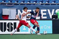 FOXBOROUGH, MA - JUNE 26: Dominick Hernandez #80 of North Texas SC tackles Damian Rivera #72 of the New England Revolution during a game between North Texas SC and New England Revolution II at Gillette Stadium on June 26, 2021 in Foxborough, Massachusetts.