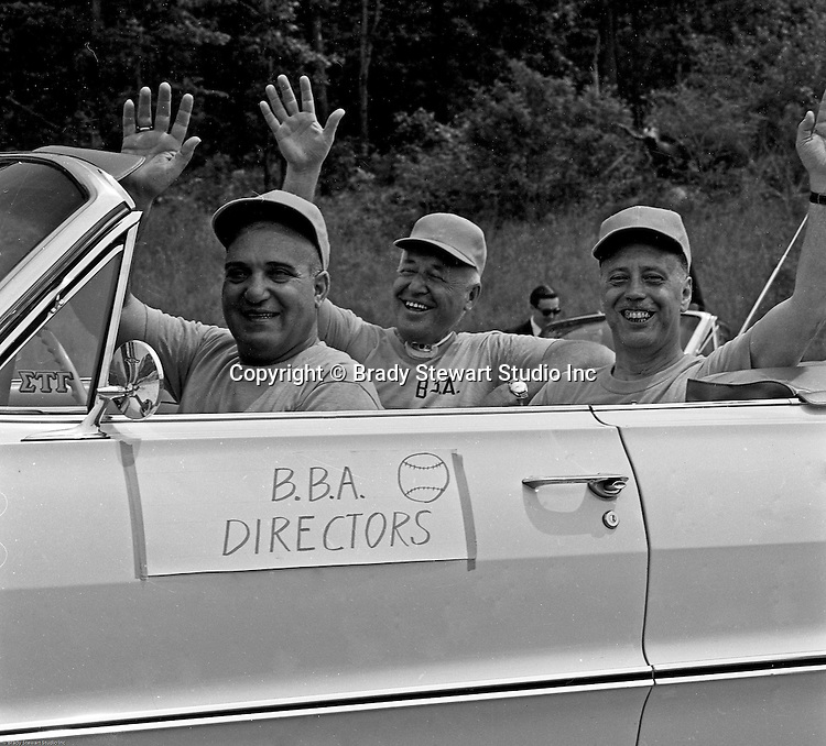 Bethel Park PA:  Bethel Park Athletic Association Directors riding in a car during the annual parade for the Bethel Baseball Association.  The BBA was very successful in teaching the young boys how to play baseball the right way.  The proof was that Bethel Park High School Baseball teams were some of the most successful in WPIAL history.  In the car; Chet Lucido, and Nick Smergin