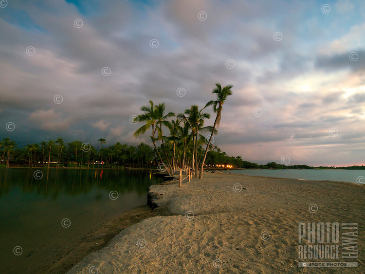 Twilight at 'Anaeho'omalu Bay, including the Lava Lava Beach Club, Waikoloa, Big Island.