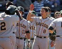 Baylor 3B Shaver Hansen greets his teammates against Texas on May 3rd, 2008. Photo by Andrew Woolley / Four Seam Images