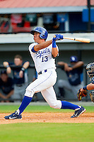Pedro Gonzalez (13) of the Burlington Royals follows through on a pinch-hit 2-run home run against the Princeton Rays at Burlington Athletic Park on July 5, 2013 in Burlington, North Carolina.  The Royals defeated the Rays 5-1 in game one of a doubleheader.  (Brian Westerholt/Four Seam Images)