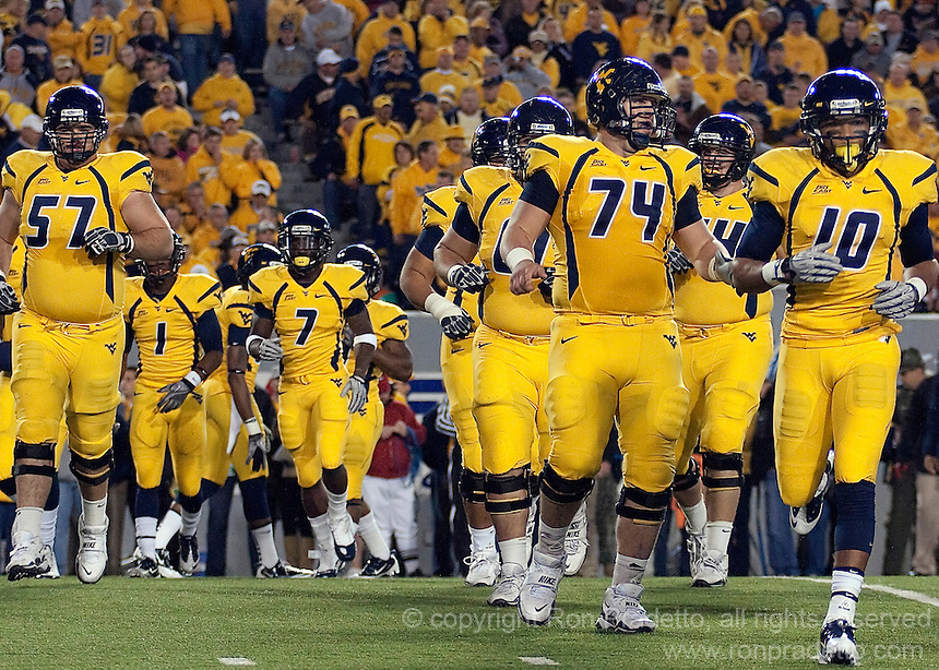 WVU offense takes the field.  The West Virginia Mountaineers defeated the South Florida Bulls 20-6 on October 14, 2010 at Mountaineer Field, Morgantown, West Virginia.