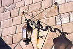 Scotty's Castle<br />Death Valley California<br />A serpentine bracket slung on chains distinguishes this six-sided lantern, with the wall's rusticated stucco finish providing the perfect backdrop.