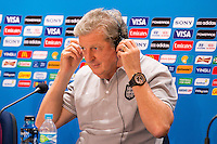 England manager Roy Hodgson listens to translations in headphones during a press conference