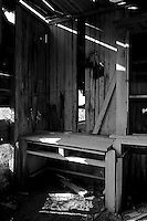 A counter and cabinet inside the Precita Gun Club slowly sinks into the marsh at the ghost town of Drawbridge in southern San Francisco Bay. Drawbridge was a hunting village started in the 1880's with the last resident leaving in the 1970's.
