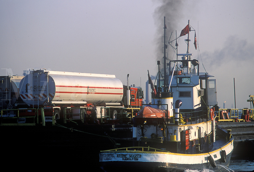 Hazardous materials are transported on barges pushed by tug boat back and fourth across the Detroit River to Ontario.