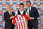 Atletico de Madrid's new player Angel Correa (c) with the President Enrique Cerezo (l) and the General Manager Jose Luis Perez Caminero during his official presentation. July 10, 2015. (ALTERPHOTOS/Acero)