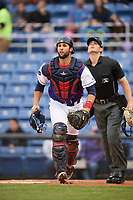 Binghamton Rumble Ponies catcher Colton Plaia (26) and umpire Richard Riley watch the play during a game against the Akron RubberDucks on May 12, 2017 at NYSEG Stadium in Binghamton, New York.  Akron defeated Binghamton 5-1.  (Mike Janes/Four Seam Images)