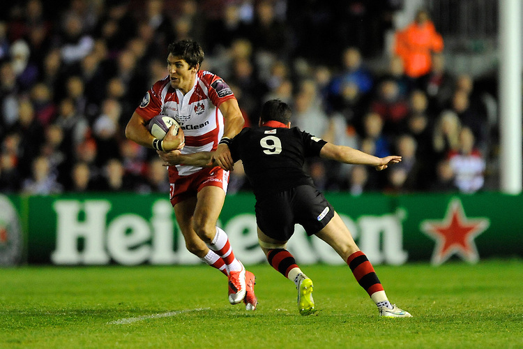 James Hook of Gloucester Rugby goes round Sam Hidalgo-Clyne of Edinburgh Rugby