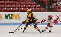 Boston, Massachusetts - December 10, 2016: NCAA Division I. In overtime, Boston University (white) defeated University of Minnesota (maroon), 6-5 in women's hockey, at Walter Brown Arena.