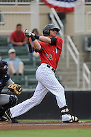 First baseman Danny Hayes (32) of the Kannapolis Intimidators bats in a game against the Charleston RiverDogs on Saturday, June 28, 2014, at CMC-Northeast Stadium in Kannapolis, North Carolina. Kannapolis won, 4-3. (Tom Priddy/Four Seam Images)