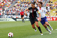 14 MAY 2011: USA Women's National Team midfielder Carli Lloyd (10) goes for the ball as Japan National team Kozue Ando defends during the International Friendly soccer match between Japan WNT vs USA WNT at Crew Stadium in Columbus, Ohio.