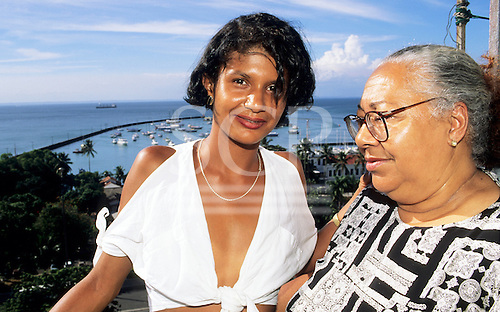 Salvador, Bahia, Brazil. Old lady with transvestite young man overlooking the harbour.