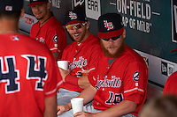 Louisville Bats Bryson Smith (3) and Chris Berset (10) in the dugout before a game against the Buffalo Bisons on June 23, 2016 at Coca-Cola Field in Buffalo, New York.  Buffalo defeated Louisville 9-6.  (Mike Janes/Four Seam Images)