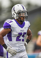 8 October 2016: Amherst College Purple & White Running Back Hasani Figueroa, a Junior from Bronx, NY, is attentive to coaching on the sidelines during a game against the Middlebury College Panthers at Alumni Stadium in Middlebury, Vermont. The Panthers edged out the Purple & While 27-26. Mandatory Credit: Ed Wolfstein Photo *** RAW (NEF) Image File Available ***