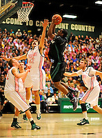 13 February 2011: Binghamton University Bearcat forward Greer Wright, a Senior from  Boynton Beach, FL, jumps for a shot against the University of Vermont Catamounts at Patrick Gymnasium in Burlington, Vermont. The Catamounts came from behind to defeat the Bearcats 60-51 in their America East matchup. The Cats took part in the National Pink Zone Breast Cancer Awareness Program by wearing special white jerseys with pink trim. The jerseys were auctioned off following the game with proceeds going to the Vermont Cancer Center. Mandatory Credit: Ed Wolfstein Photo