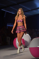 MIAMI BEACH, FLORIDA - JULY 14: A model walks the runway for Chloe Rose Swimwear Show at The Paraiso Tent on July 14, 2019 in Miami Beach, Florida.<br />