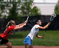 Kristen Carr (6) of North Carolina sprints away from Karri Ellen Johnson (18) of Maryland during the ACC women's lacrosse tournament finals in College Park, MD.  Maryland defeated North Carolina, 10-5.