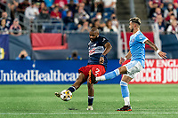 FOXBOROUGH, MA - SEPTEMBER 11: Andrew Farrell #2 of New England Revolution passes the ball as Valentin Castellanos #11 of New York City FC defends during a game between New York City FC and New England Revolution at Gillette Stadium on September 11, 2021 in Foxborough, Massachusetts.