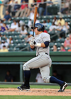 Outfielder Tyler Austin (11) of the Charleston RiverDogs, a New York Yankees affiliate, in a game against the Greenville Drive on June 21, 2012, at Fluor Field at the West End in Greenville, South Carolina. Charleston won, 2-1. Austin is the Yankees' No. 20 prospect, according to Baseball America. (Tom Priddy/Four Seam Images)