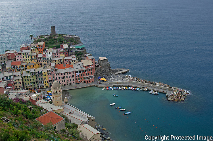 View of the italian town of Vernazza from a winery on top of the mountain.