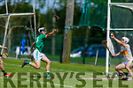 Lixnaw keeper Martin Stackpoole catches the sliotar as Ballyduffs Kevin Goulding bears down on goal, in the NK Hurling Championship game on Monday.