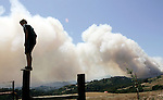 Jack Pickard, who was evacuated due to the moving wildfire, gets a better view of the fire in Corralitos, Calif., Thursday, May 22, 2008. A wind-whipped wildfire burning out of control threatened several homes in the Santa Cruz Mountains on Thursday, closing schools and prompting some evacuations. The blaze, first reported around 5:30 a.m., according to the California Department of Forestry and Fire Protection.  (AP Photo/Paul /Sakuma)