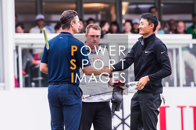 Justin Rose of England  shakes hands with Haotong Li of China during the day three of UBS Hong Kong Open 2017 at the Hong Kong Golf Club on 25 November 2017, in Hong Kong, Hong Kong. Photo by Marcio Rodrigo Machado / Power Sport Images