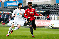 Sunday 18 March 2018<br /> Pictured:  Matic Paljk of Swansea City challenges Ethan Laird of Manchester United<br /> Re: Swansea City v Manchester United U23s in the Premier League 2 at The Liberty Stadium on March 18, 2018 in Swansea, Wales.