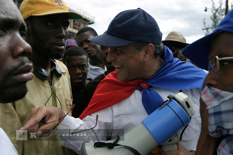 February 15, 2004. Port Au Prince, Haiti. Anti-Aristide march goes out of control with rock throwing and violence. Police used tear gas. Andy Apeid opposition leader group 184.