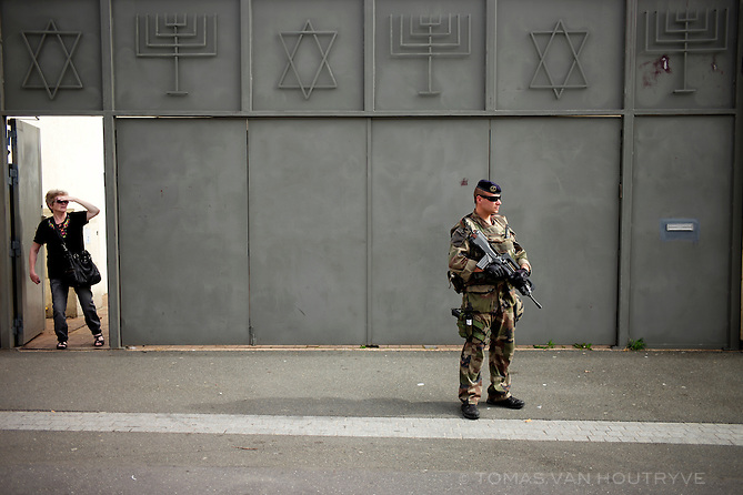 French soldier, Sergent Matthieu (last name withheld), guards a synagog in Sarcelles, near Paris, France on 22 July, 2015.