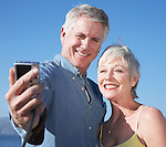 USA, California, Fairfax, Mature couple photographing self against blue sky