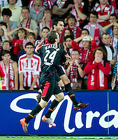 MELBOURNE, AUSTRALIA - NOVEMBER 19: Marcos Flores and Cameron Watson of Adelaide celebrate Flores' goal during the round 15 A-League match between the Melbourne Heart and Adelaide United at AAMI Park on November 19, 2010 in Melbourne, Australia (Photo by Sydney Low / Asterisk Images)
