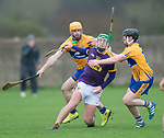 Aidan Nolan of Wexford in action against Jason Mc Carthy and Mikey O Neill of Clare during the Jack Lynch Memorial game at Tulla. Photograph by John Kelly.