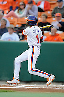 Clemson Tigers  left fielder Maleeke Gibson #1 swings at a pitch during a game against the Virginia Cavaliers  at Doug Kingsmore Stadium on March 15, 2013 in Clemson, South Carolina. The Cavaliers won 6-5.(Tony Farlow/Four Seam Images).