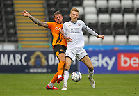 11th September 2021; Swansea.com Stadium, Swansea, Wales; EFL Championship football, Swansea versus Hull City; George Moncur of Hull City and Flynn Downes of Swansea City challenge for the ball