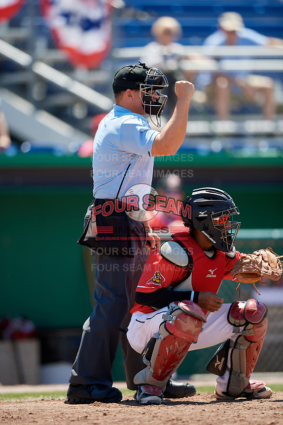 Umpire Jordan Sandberg calls a strike behind catcher Pablo Garcia (4) during a game between the State College Spikes and Batavia Muckdogs on July 8, 2018 at Dwyer Stadium in Batavia, New York.  Batavia defeated State College 8-3.  (Mike Janes/Four Seam Images)
