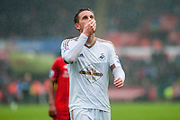 Gylfi Sigurdsson of Swansea City  looks up at the clock during  the Barclays Premier League match between Swansea City and Liverpool played at the Liberty Stadium, Swansea  on May the 1st  2016