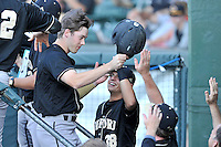 Alex Malsch (19) of the Wofford Terriers is congratulated after scoring a run against the Western Carolina Catamounts in a SoCon Tournament game on Wednesday, May 25, 2016, at Fluor Field at the West End in Greenville, South Carolina. Western won, 10-9. (Tom Priddy/Four Seam Images)