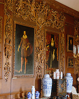 The Carved Room at Petworth House features a pair of beautifully carved picture frames by Grinling Gibbons